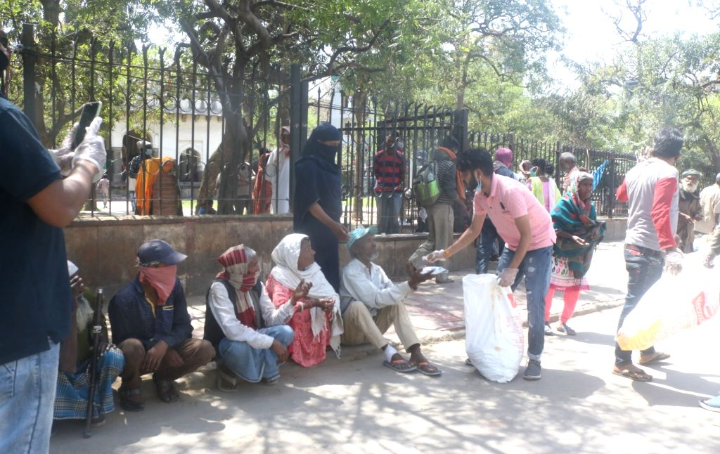Food being distributed among poor and needy people during the 21-day nationwide lockdown imposed to contain the coronavirus, in New Delhi on March 31, 2020.