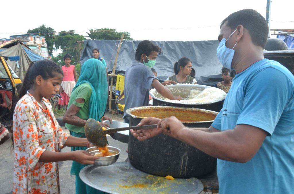 Food being distributed among the flood victims at a village in Bihar's flood-hit Muzaffarpur on Aug 2, 2020.