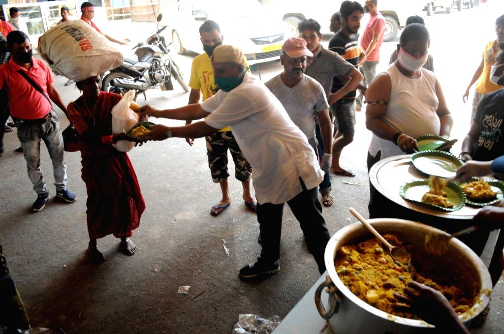 Food being distributed among the poor, needy and homeless on Day 6 of the 21-day countrywide lockdown imposed to contain the spread of novel coronavirus, in Kolkata on March 30, 2020.