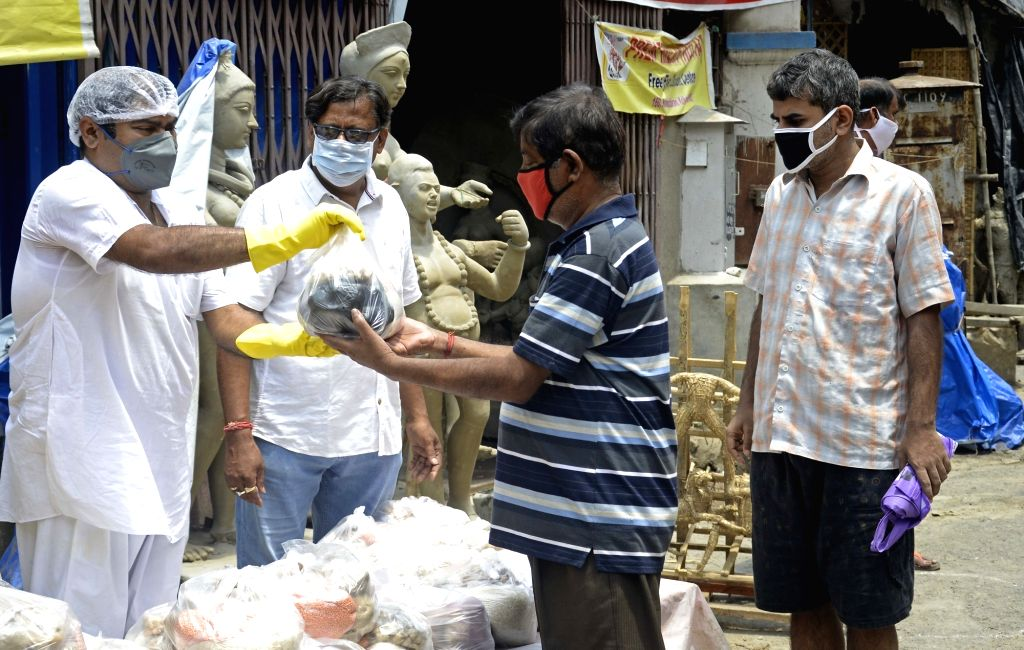 Food being distributed among the poor, needy and homeless people in Kolkata during the extended nationwide lockdown imposed to mitigate the spread of coronavirus; on Apr 26, 2020.