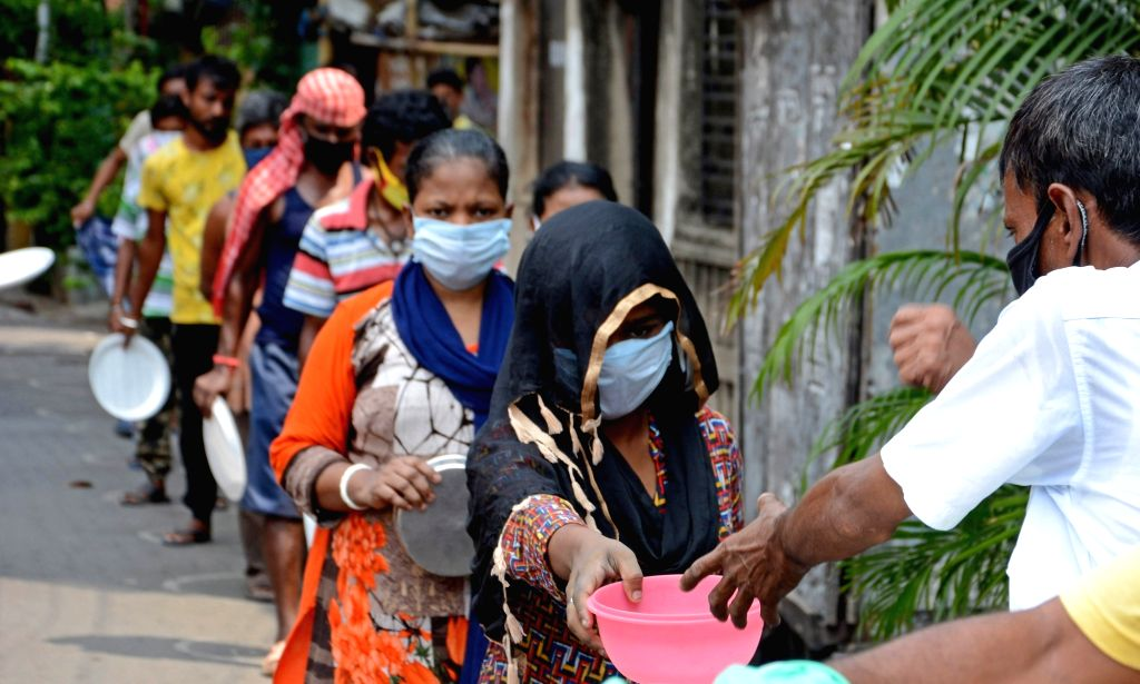Food being distributed among the poor needy and homeless people in Kolkata during the extended nationwide lockdown imposed to mitigate the spread of coronavirus, on May 7, 2020.