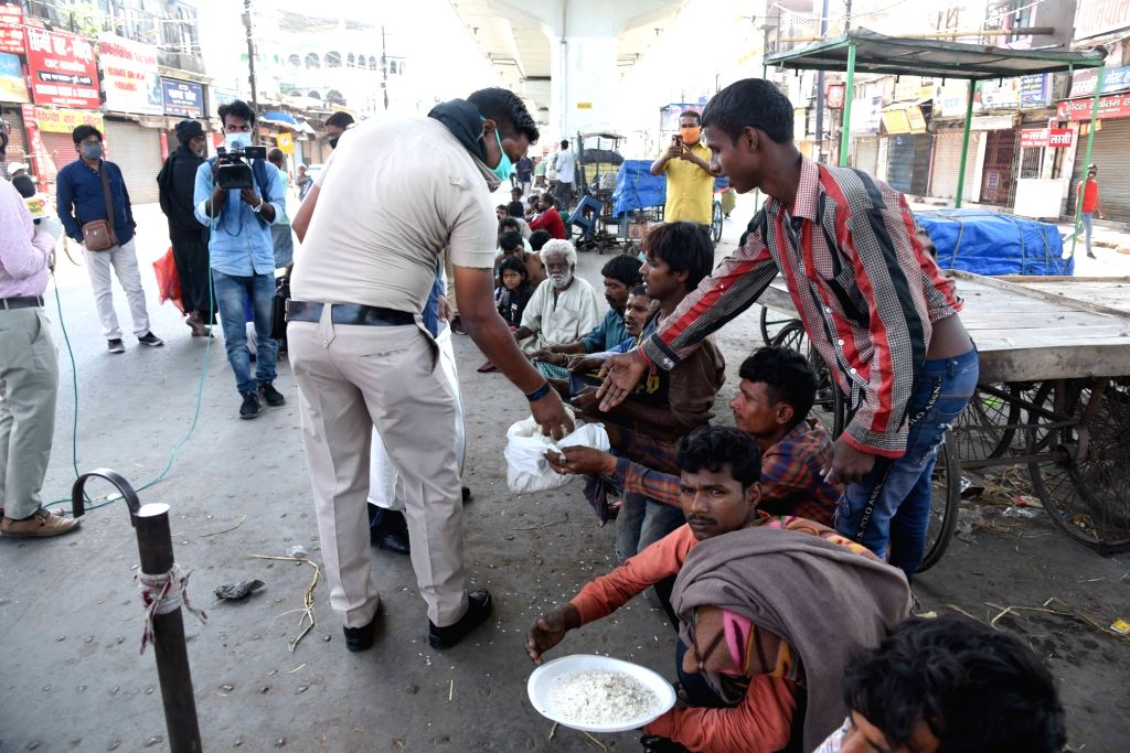 Food being distributed among the poor outside the Mahaveer Temple on Day 2 of the 21-day nationwide lockdown imposed by the Narendra Modi government over the coronavirus pandemic; in Patna on ... - Narendra Modi