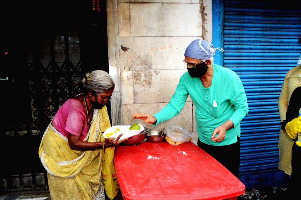 Food being distributed among the poor people by social workers during the fifth phase of the nationwide lockdown imposed in the wake of the corona pandemic, in Kolkata on July 3, 2020.