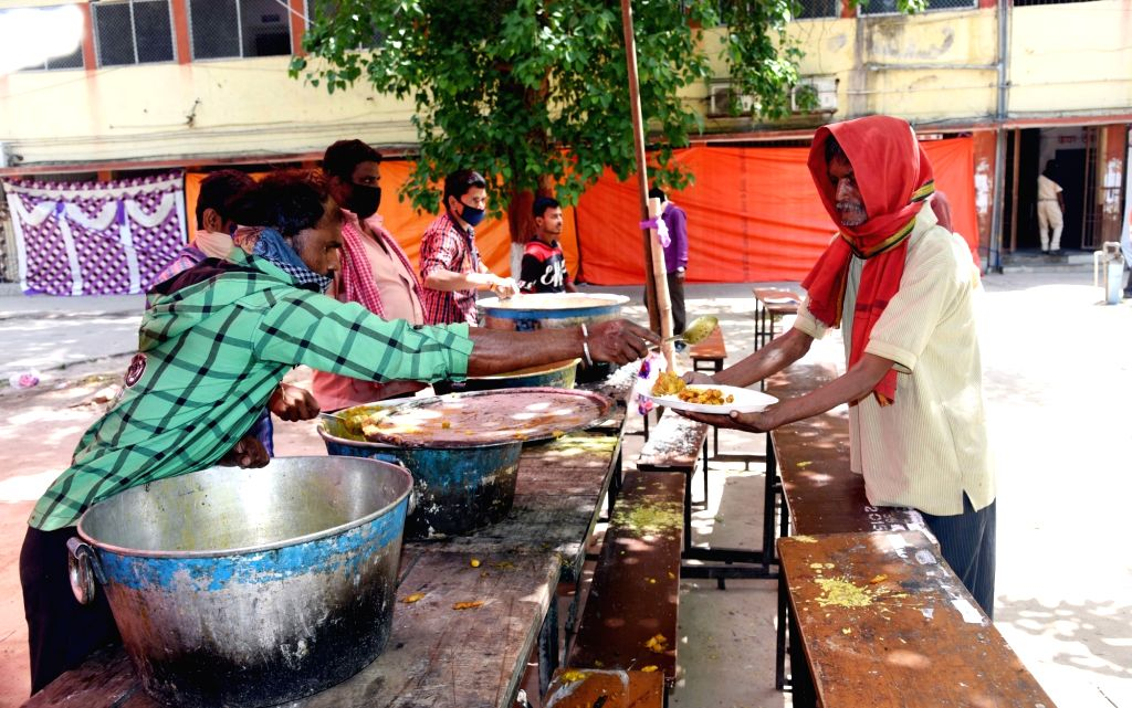 Food being distributed free of cost among the poor, needy and homeless people at College of Commerce, Arts and Science in Patna during the 21-day nationwide lockdown imposed as a precautionary ...