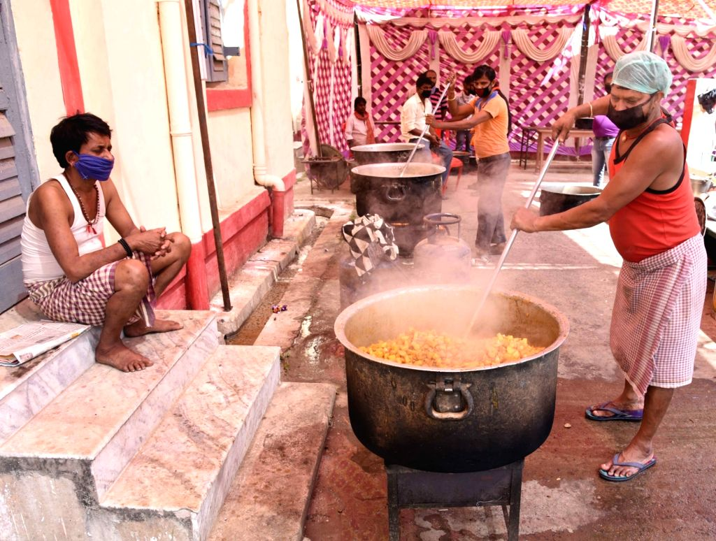 Food being prepared for migrant workers sheltered at a relief camp set up at a school on Day 7 of the 21-day nationwide lockdown imposed as a measure to contain the spread of  coronavirus, in ...