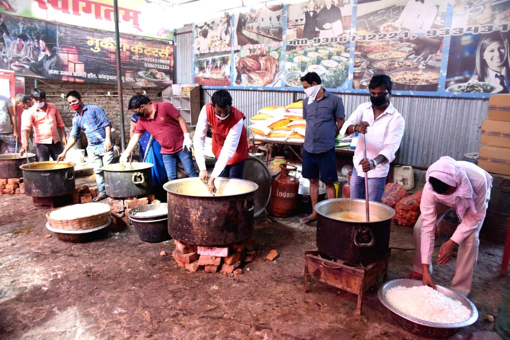 Food being prepared to be distributed among the poor, needy and homeless people on Day 7 of the 21-day nationwide lockdown imposed as a measure to contain the spread of  coronavirus, in Patna ...