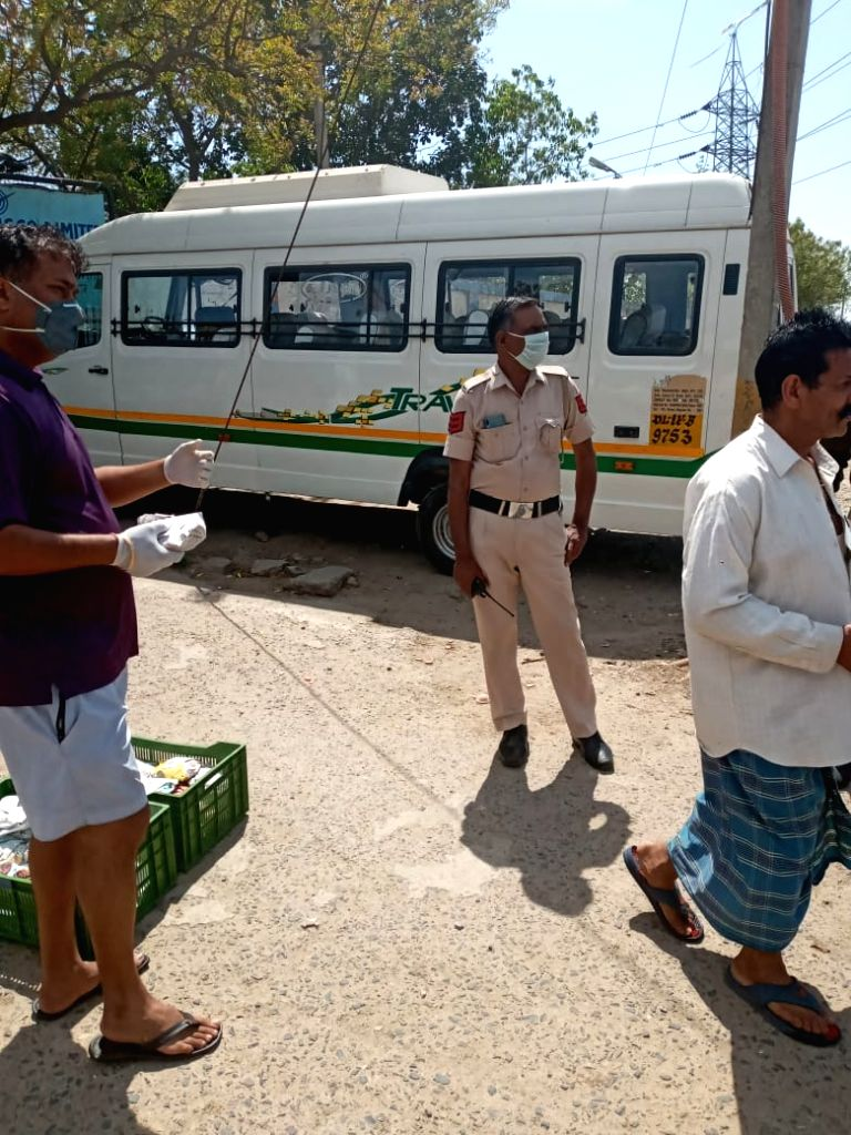 Food distributed at Priyanka camp during 21-day nationwide lockdown imposed to contain the spread of coronavirus.