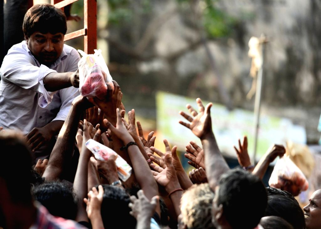 Food packets being distributed to people affected by floods in Chennai on Dec 7, 2015.