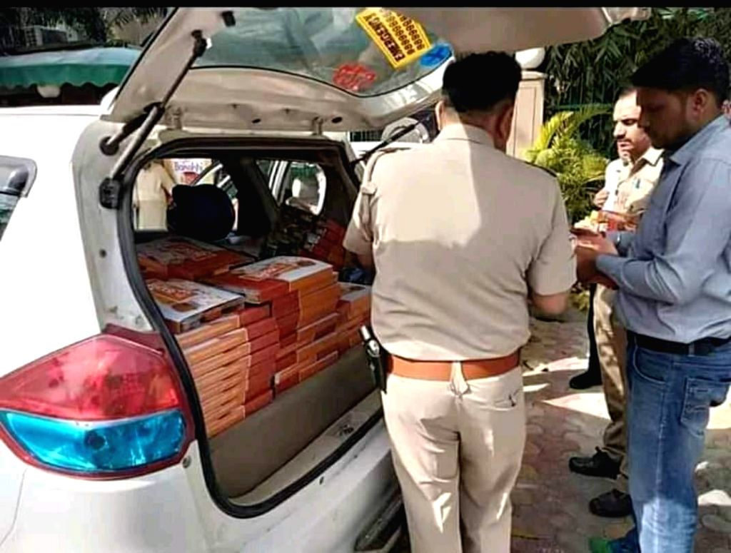 Food packets with 'Namo' written over the boxes were distributed among polling officials at some booths in Noida, on April 11, 2019. According to the authorities the food packets had nothing ...