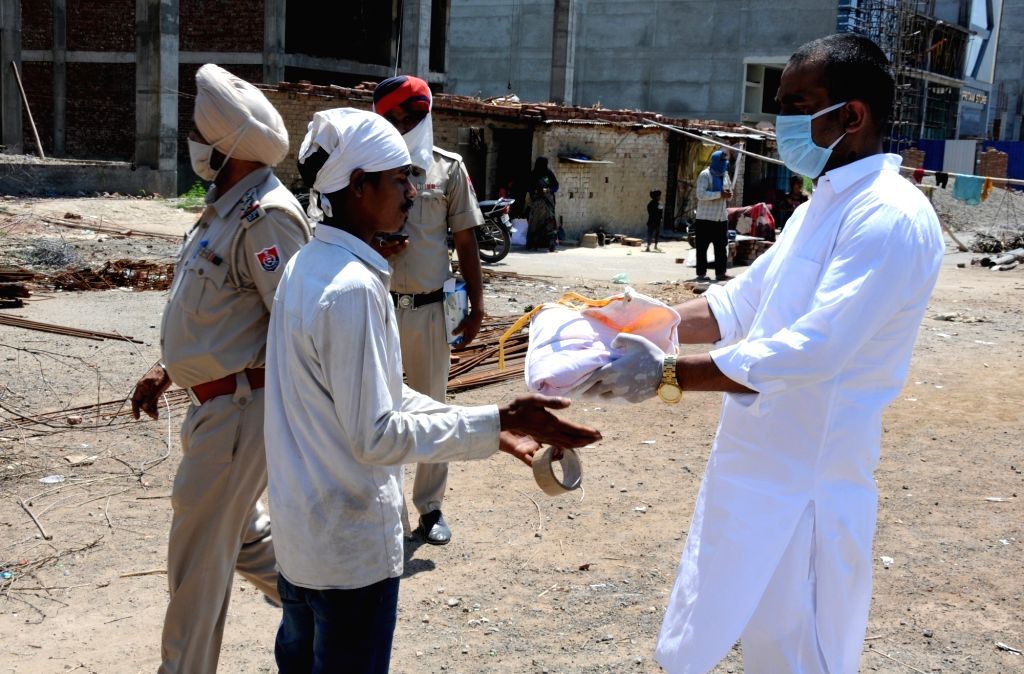 Foodgrains being distributed among the needy in Amritsar during the extended nationwide lockdown imposed to mitigate the spread of coronavirus; on Apr 23, 2020.