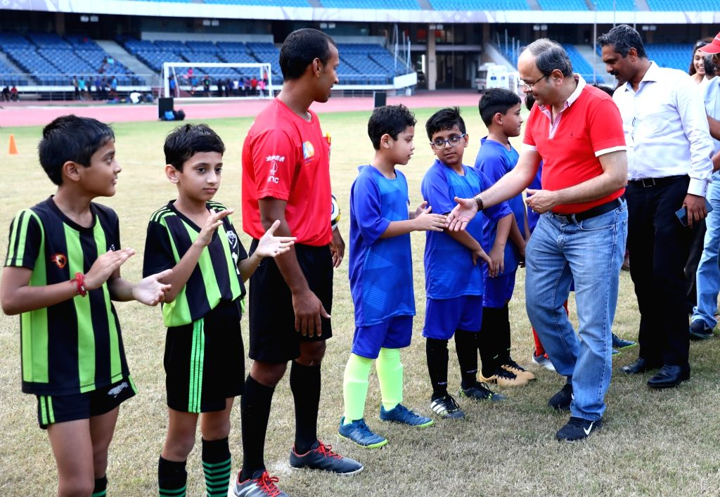 Football Delhi President Shaji Prabhakaran and ONGC GM (HR) - Head Corporate Sports Dr. Shivendra Dutt Shukla with the budding young footballers during the launch of the Golden League ... - Shivendra Dutt Shukla