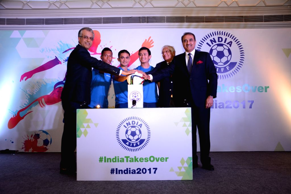 Footballers Chuni Goswami, Baichung Bhutia and Sunil Chhetri pass on the baton to the captain of the U-17 football team as India gears up for the FIFA U-17 World Cup India 2017 in New ... - Chuni Goswami
