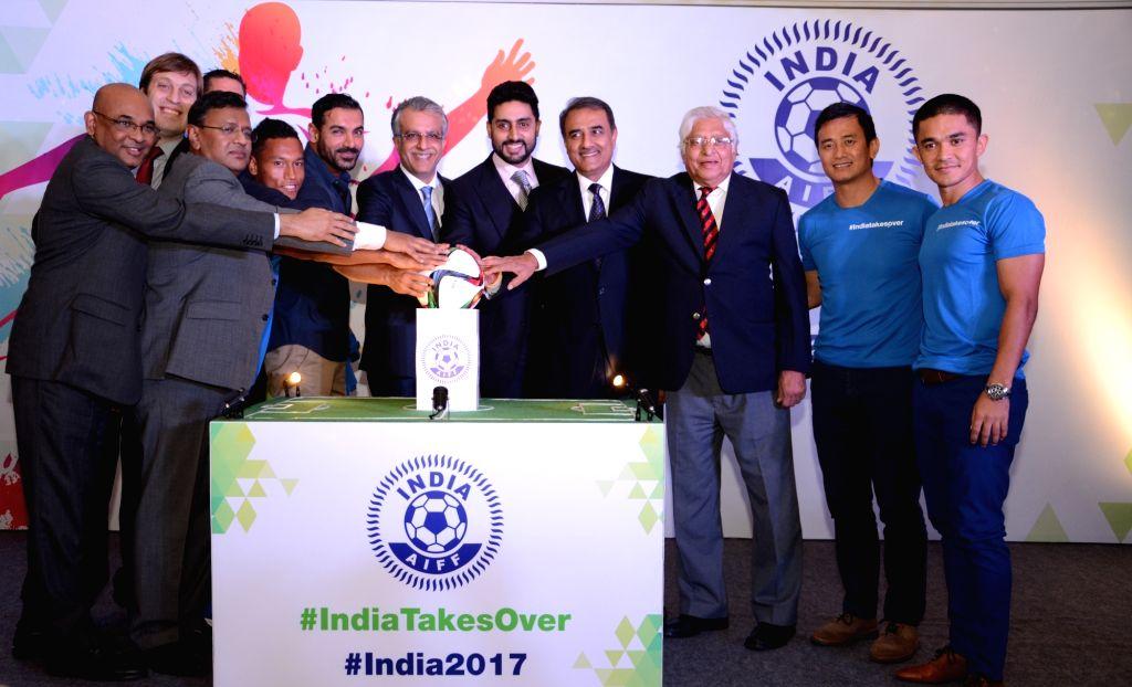 Footballers Chuni Goswami, Baichung Bhutia and Sunil Chhetri pass on the baton to the captain of the U-17 football team as India gears up for the FIFA U-17 World Cup India 2017 in New ... - John Abraham, Abhishek Bachchan, Chuni Goswami and Praful Patel