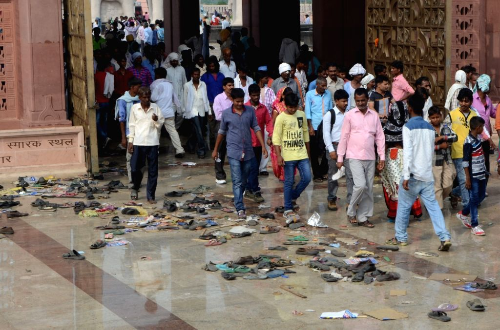 Footwear strewn at the venue of BSP chief Mayawati's rally where a stampede broke-out in Lucknow on Oct 9, 2016. Two aged women were killed and more than a dozen others injured in the ...