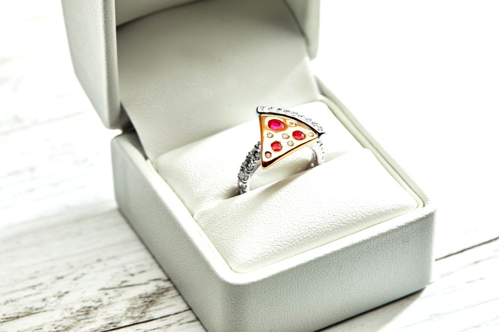 """For the Valentine's day this year, Domino's Australia has unveiled an engagement ring worth $9,000 for """"one lucky pizza lover"""". The shared post reads: """"Does someone have a 'pizza' your ..."""