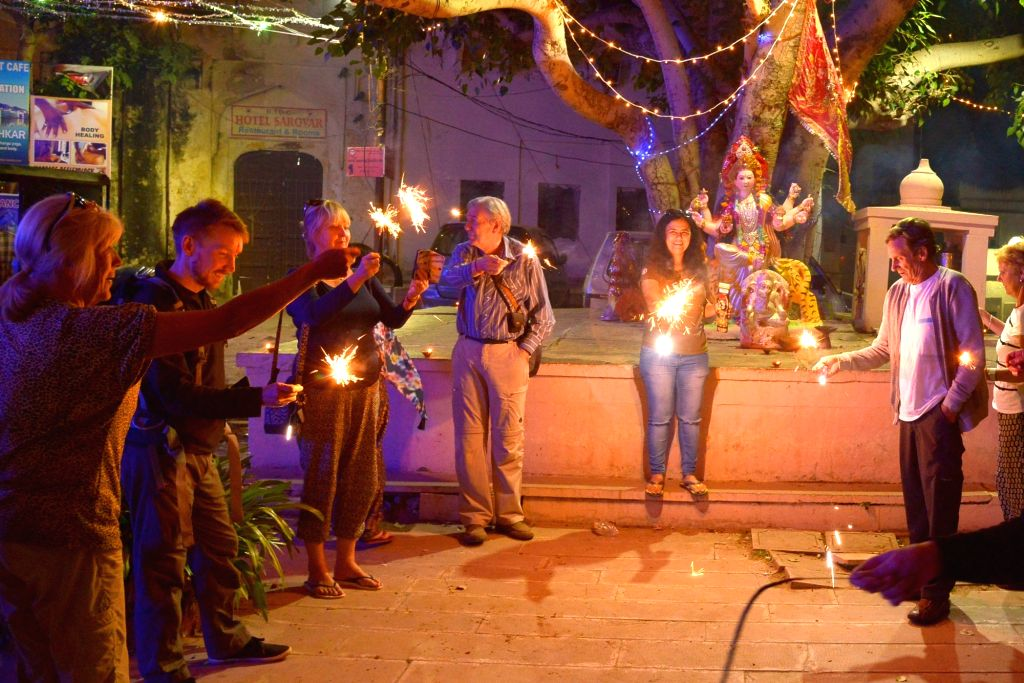 Foreign tourists celebrate Diwali with firecrackers in Pushkar of Rajasthan on Oct 30, 2016.