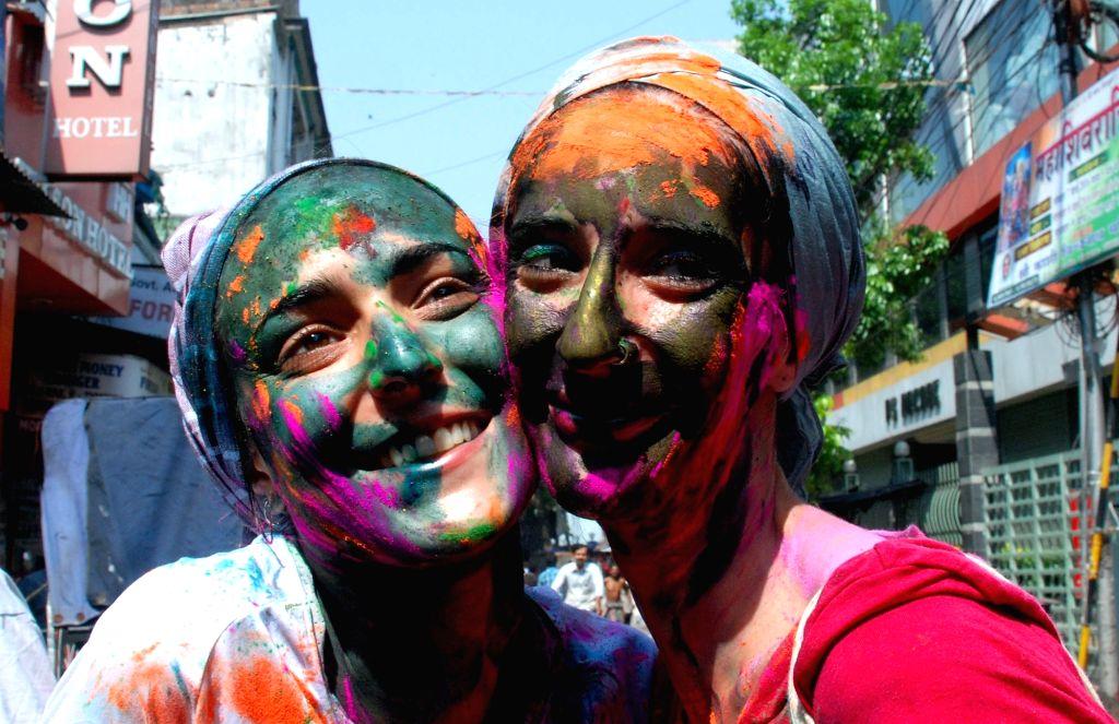 Foreign tourists celebrate Holi in Kolkata, on March 23, 2016.