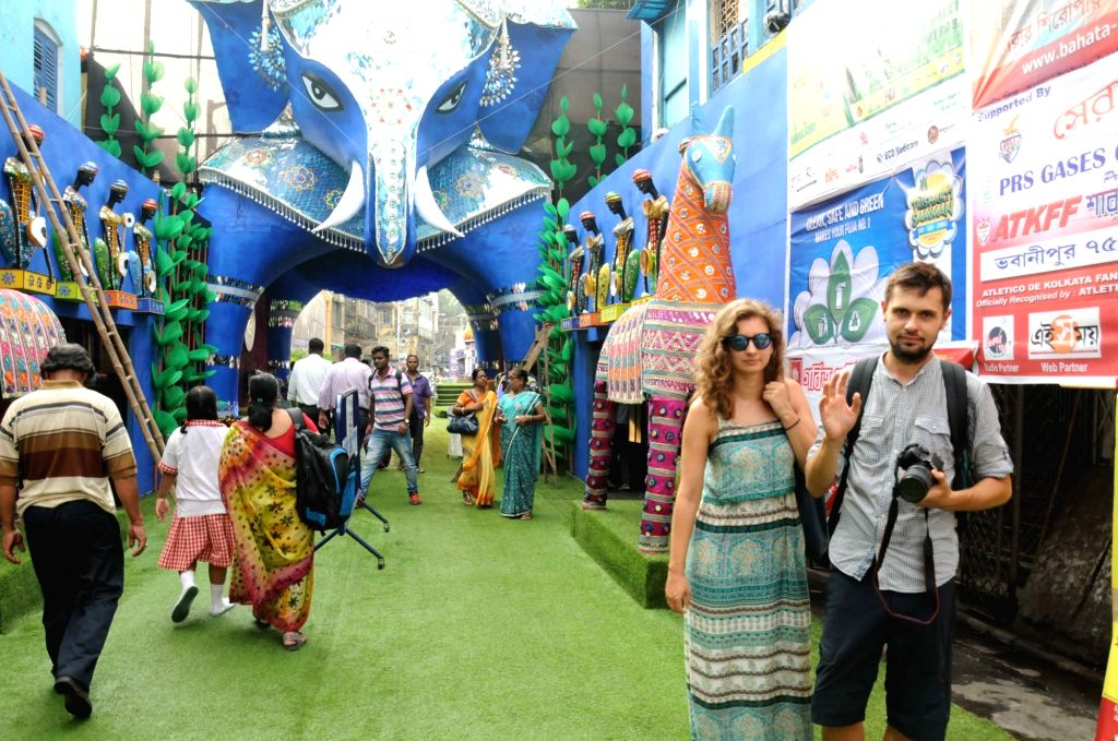 Foreign tourists visit at 75 Pally Durga Puja of Bhawanipur in Kolkata on Oct 4, 2016.
