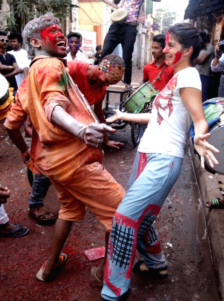 Foreigners play holi with locals in Kolkata on March 12, 2017.
