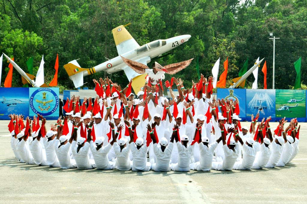 Formation with the National Flag by trainees on the occasion of passing out parade at Air Force Station, Jalahalli, in Bengaluru, on April 22, 2016.