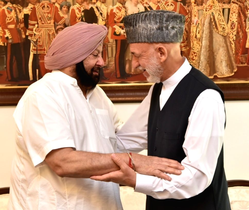 Former Afghan President Hamid Karzai meets Punjab Chief Minister Captain Amarinder Singh, in Chandigarh on Sept 20, 2018. - Captain Amarinder Singh