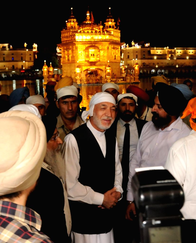 Former Afghanistan President Hamid Karzai pays obeisance at the Golden Temple in Amritsar on Sept 20, 2018.