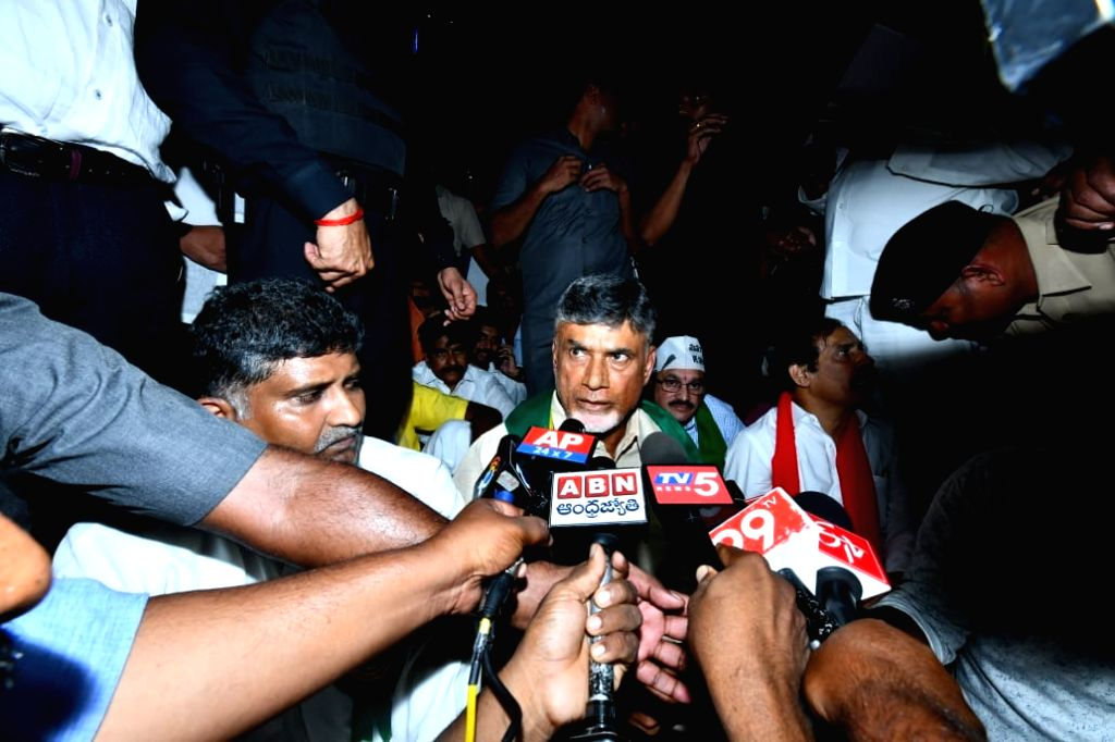 Former Andhra Pradesh Chief Minister and TDP President N. Chandrababu Naidu talks to the media as he stages a sit-in demonstration against police behavior at Benz Circle ahead of ... - N. Chandrababu Naidu