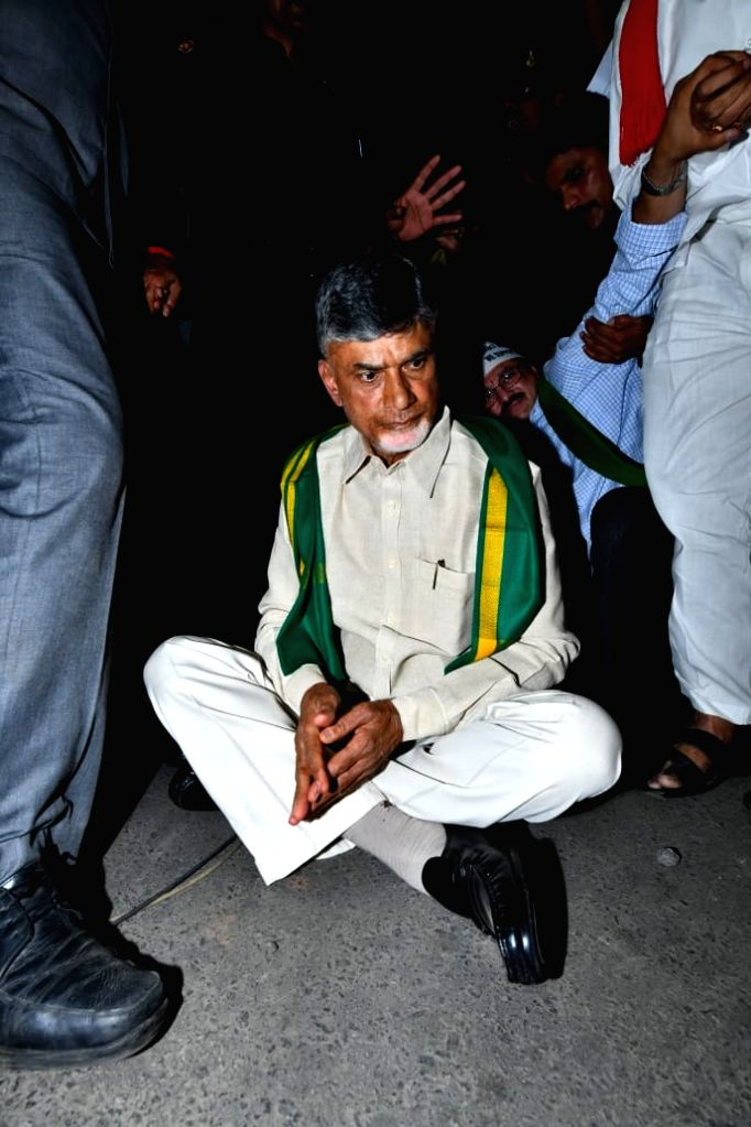 Former Andhra Pradesh Chief Minister and TDP President N. Chandrababu Naidu stages a sit-in demonstration against police behavior at Benz Circle ahead of embarking on a 'bus yatra' as ... - N. Chandrababu Naidu