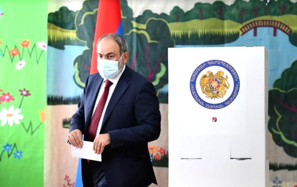 Former Armenian President Levon Ter-Petrosyan casts his ballot at a polling station in Yerevan, Armenia, June 20, 2021.