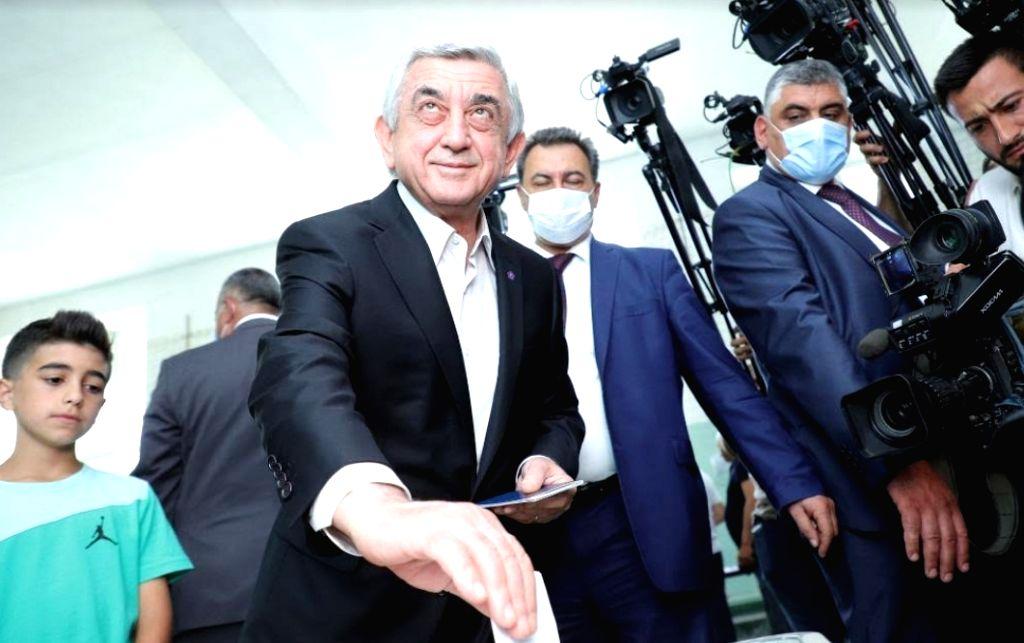 Former Armenian President Serzh Sargsyan casts his ballot at a polling station in Yerevan, Armenia, June 20, 2021.