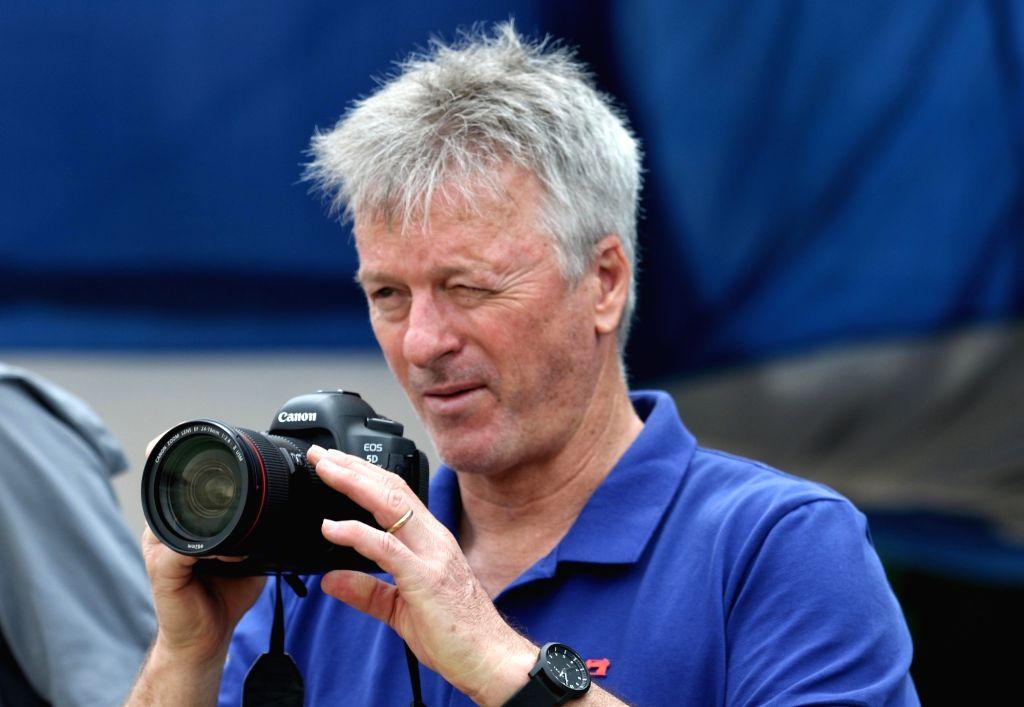 Former Australian captain Steve Waugh clicks photographs during a Ranji Trophy match between Delhi and Bengal at the Edeen Gardens in Kolkata on Jan 27, 2020. - Steve Waugh