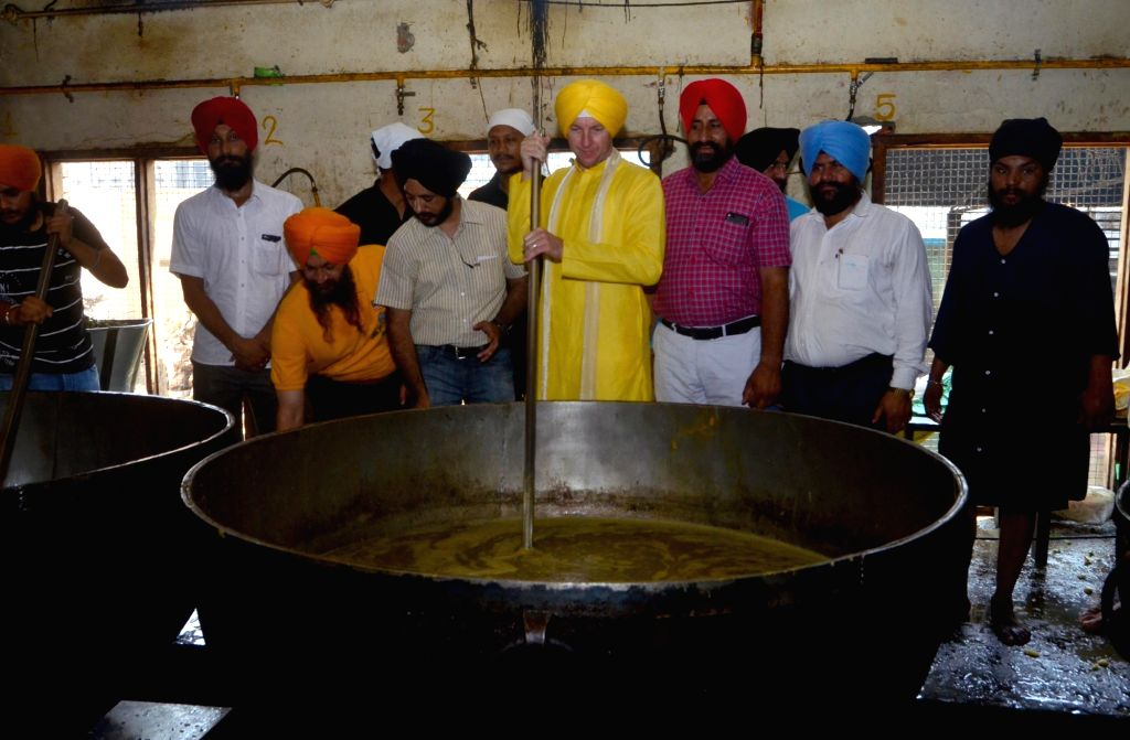 Former Australian cricketer Brett Lee helps in the preparation of  'langar' during his visit to the Golden Temple in Amritsar on May 29, 2018.