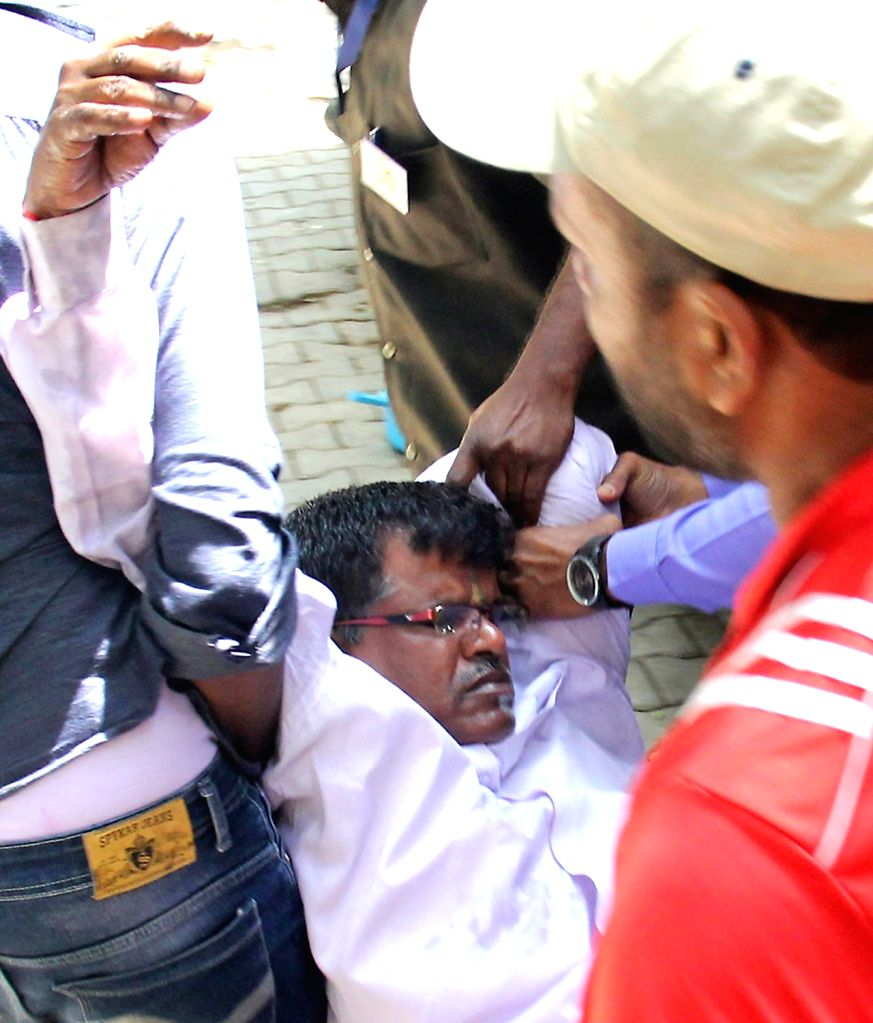 Former BBMP councilor V Nagaraj alias Bomb Naga being taken away after he attempted suicide by consuming poison during a press meet at Bangalore press club in Bengaluru on April 6, 2018.