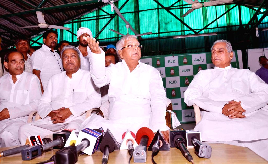 Former Bihar Chief Minister and RJD chief Lalu Prasad Yadav addresses a press conference regarding his party's performance in Patna on May 16, 2014. - Lalu Prasad Yadav