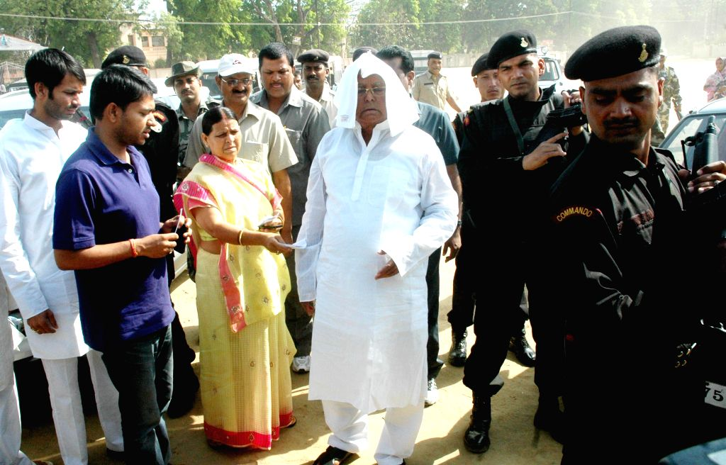 Former Bihar Chief Ministers Rabri Devi and Lalu Prasad Yadav arrive to cast their vote during the fifth phase of 2014 Lok Sabha Polls in Patna on April 17, 2014.