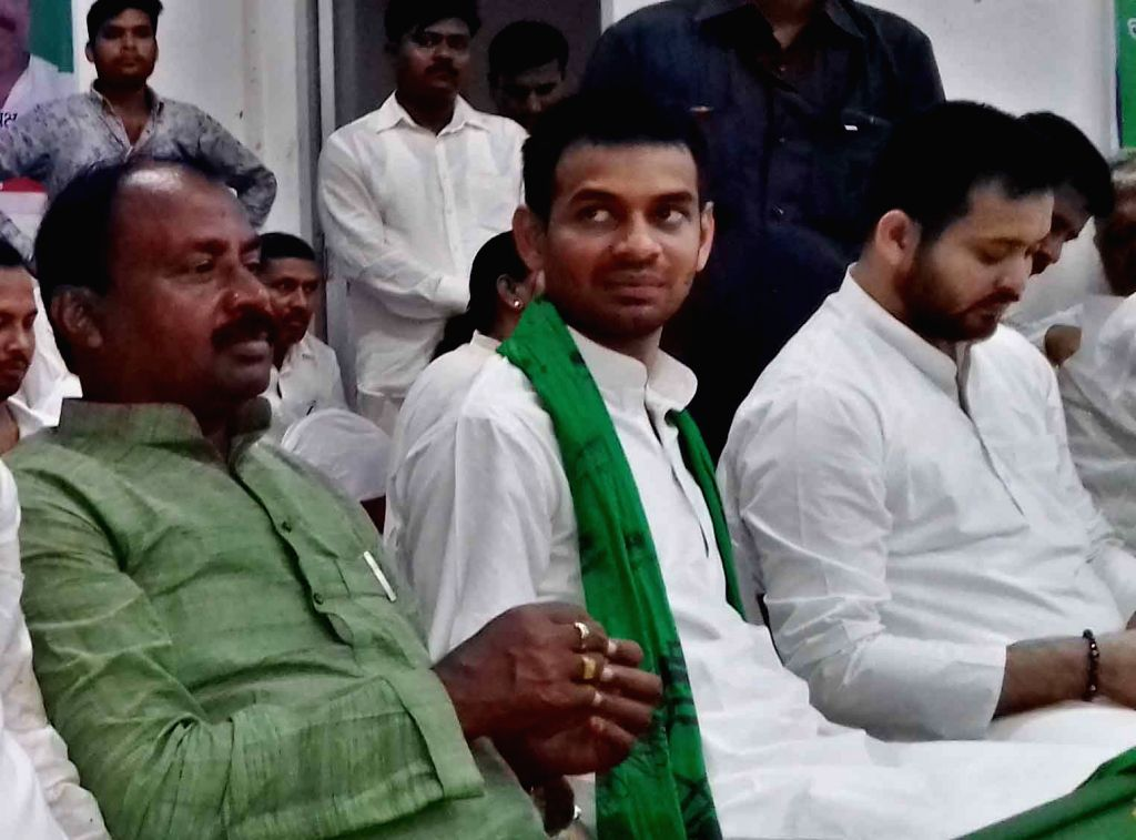 Former Bihar Deputy Chief Minister Tejashwi Yadav and Former Bihar Health Minister Tej Pratap Yadav during a programme in Patna on Aug 10, 2017. - Tejashwi Yadav and Tej Pratap Yadav
