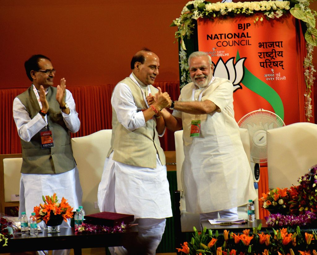 Former BJP President and Union Home Minister Rajnath Singh congratulating Prime Minister Narendra Modi for his success in the General Election during the BJP National Council meeting in New Delhi on . - Rajnath Singh and Narendra Modi