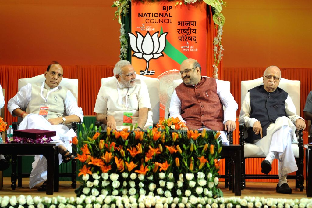 Former BJP President and Union Home Minister Rajnath Singh, Prime Minister Narendra Modi, Newly appointed BJP President Amit Shah and Senior BJP leader L K Advani at the BJP National Council meeting . - Rajnath Singh, Narendra Modi and L K Advani