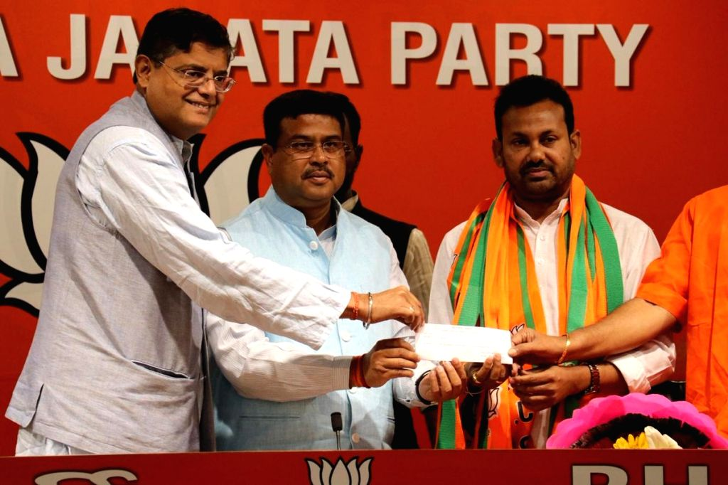 Former Congress MLA from Salepur constituency in Odisha, Prakash Chandra Behera joins BJP in the presence of Union Minister Dharmendra Pradhan at the party's headquarter in New Delhi, on ... - Dharmendra Pradhan