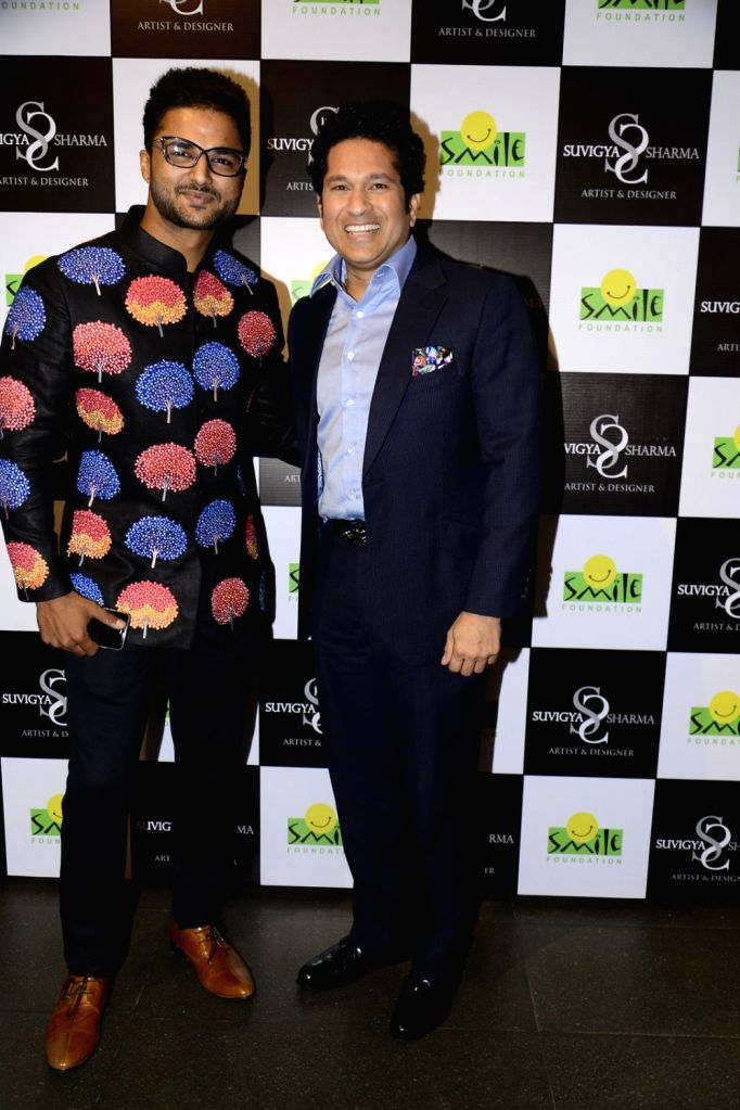 Former cricket player Sachin Tendulkar inaugurates Suvigya Sharma`s exhibtion, in Mumbai on Oct 3, 2016. - Sachin Tendulkar and Suvigya Sharma