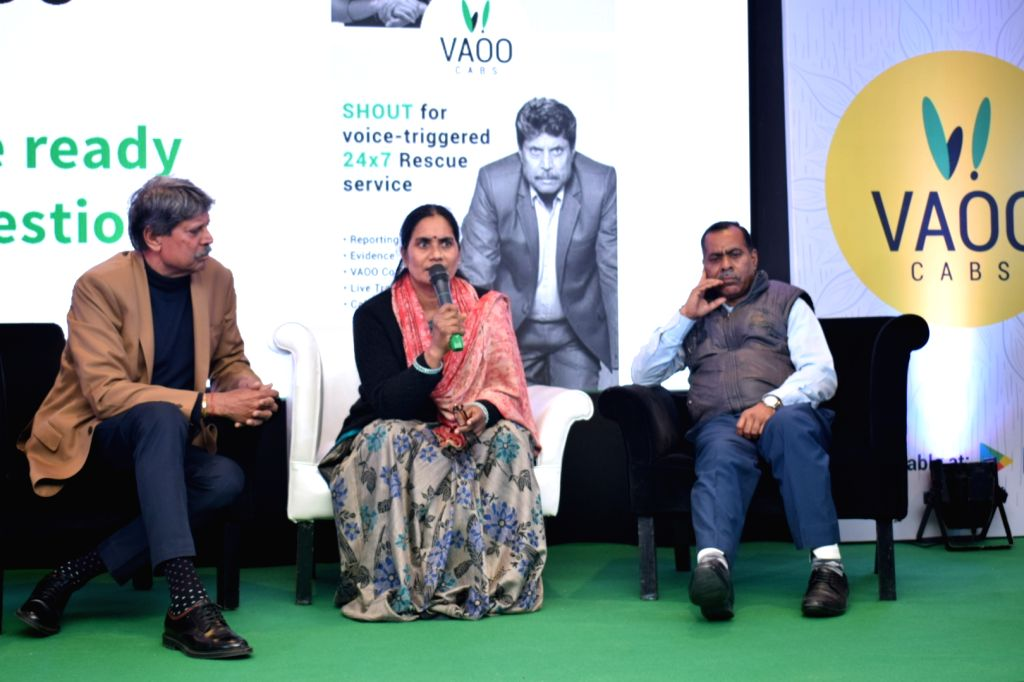 """Former cricketer Kapil Dev and 2012 Delhi gang-rape victim Nirbhaya's parents Asha Devi and Badrinath Singh at the launch of """"SHOUT"""" in-app feature of VAAO app, in New Delhi on ... - Kapil Dev and Badrinath Singh"""