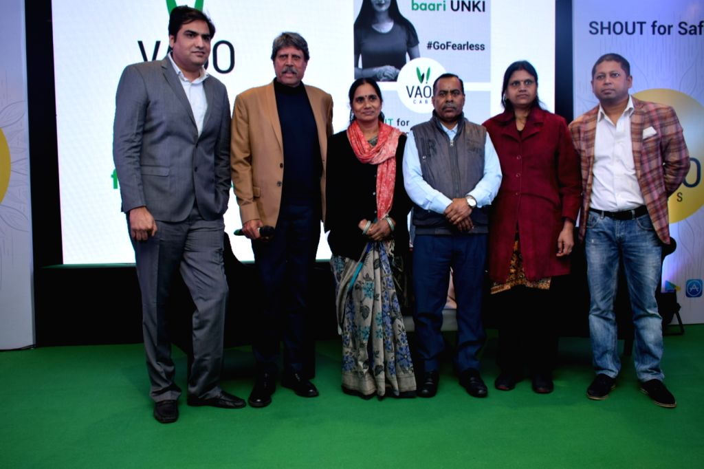 """Former cricketer Kapil Dev and 2012 Delhi gang-rape victim Nirbhaya's parents Asha Devi and Badrinath Singh with VAAO CEO Abhineet Pathak at the launch of """"SHOUT"""" in-app feature ... - Kapil Dev, Badrinath Singh and Abhineet Pathak"""