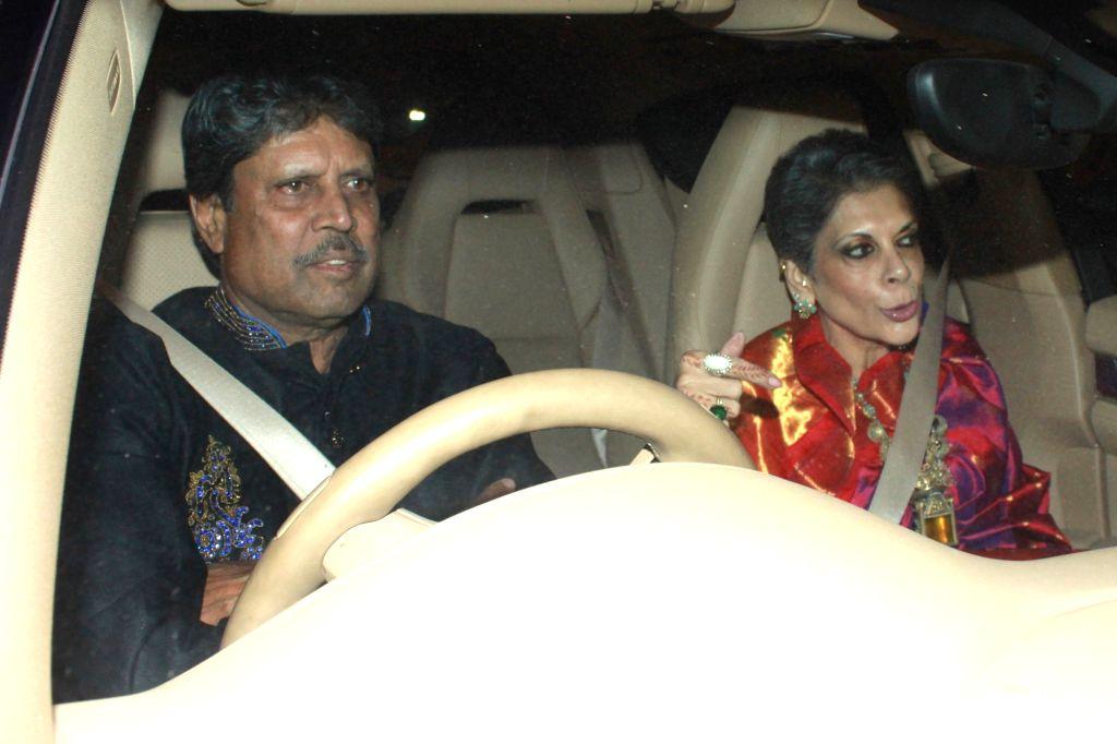 Former cricketer Kapil Dev arrives to attend the wedding reception of cricketer Harbhajan Singh and actress Geeta Basra in New Delhi, on Nov 1, 2015. - Kapil Dev