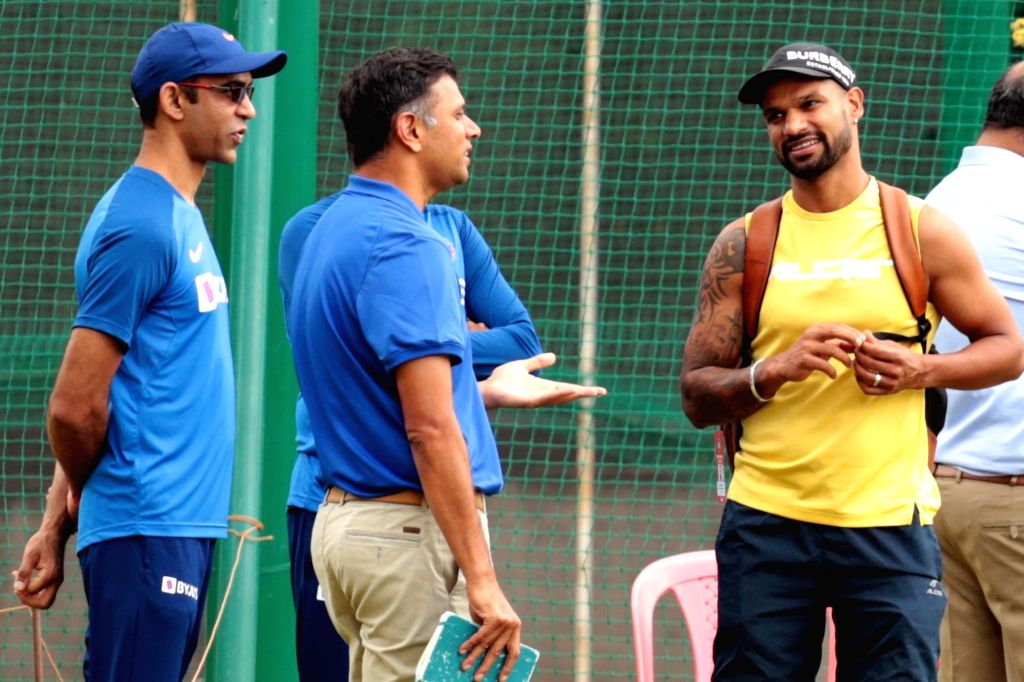 Former cricketer Rahul Dravid in a conversation with India's Shikhar Dhawan during a practice session ahead of the 3rd T20I match against South Africa at M. Chinnaswamy Stadium, in ... - Rahul Dravid and Shikhar Dhawan