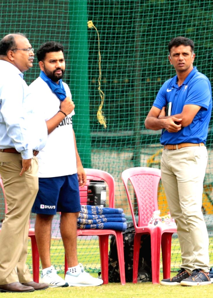 Former cricketer Rahul Dravid with India's Rohit Sharma during a practice session ahead of the 3rd T20I match against South Africa at M. Chinnaswamy Stadium, in Bengaluru on Sep 20, 2019. - Rahul Dravid and Rohit Sharma