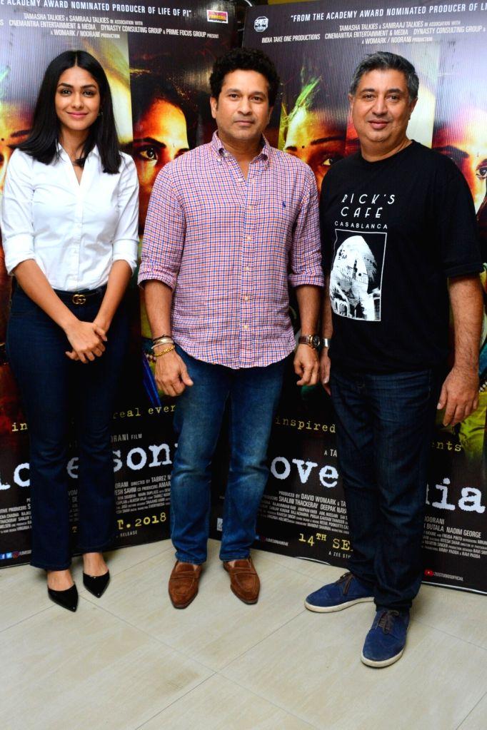 "Former cricketer Sachin Tendulkar, actress Mrunal Thakur and director Tabrez Noorani at the special screening of film ""Love Sonia"" in Mumbai on Sept 16, 2018. - Mrunal Thakur and Sachin Tendulkar"