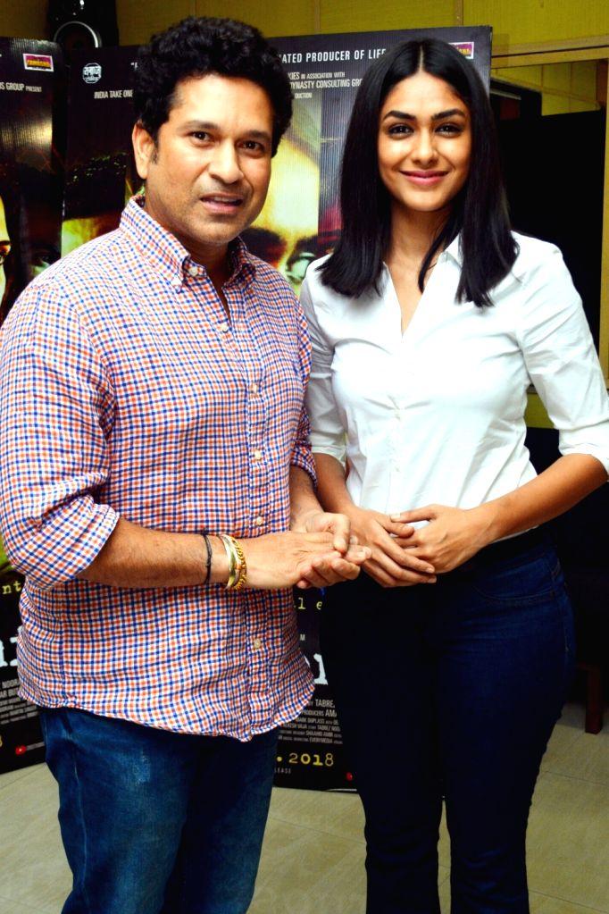 "Former cricketer Sachin Tendulkar and actress Mrunal Thakur at the special screening of film ""Love Sonia"" in Mumbai on Sept 16, 2018. - Mrunal Thakur and Sachin Tendulkar"