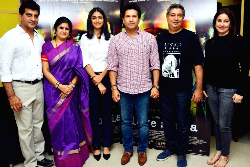 "Former cricketer Sachin Tendulkar with his wife Anjali Tendulkar, actress Mrunal Thakur and director Tabrez Noorani at the special screening of film ""Love Sonia"" in Mumbai on Sept ... - Mrunal Thakur and Sachin Tendulkar"