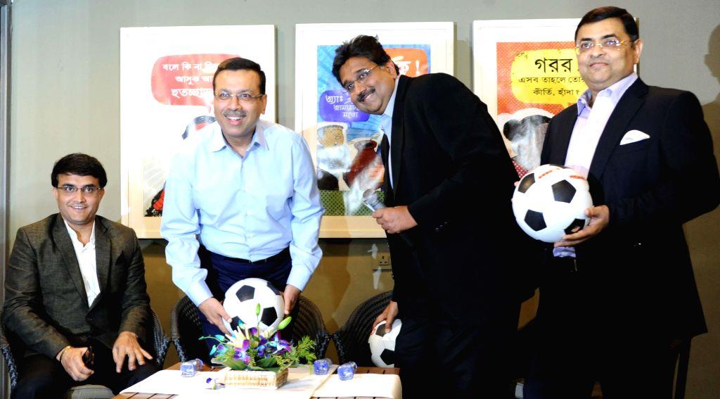 Former cricketer Saurav Ganguly with industrialists Sanjiv Goenka and Harshavardhan Neotia and Utsab Parekh during a press conference of Indian Super League in Kolkata on April 14, 2014. - Sanjiv Goenka
