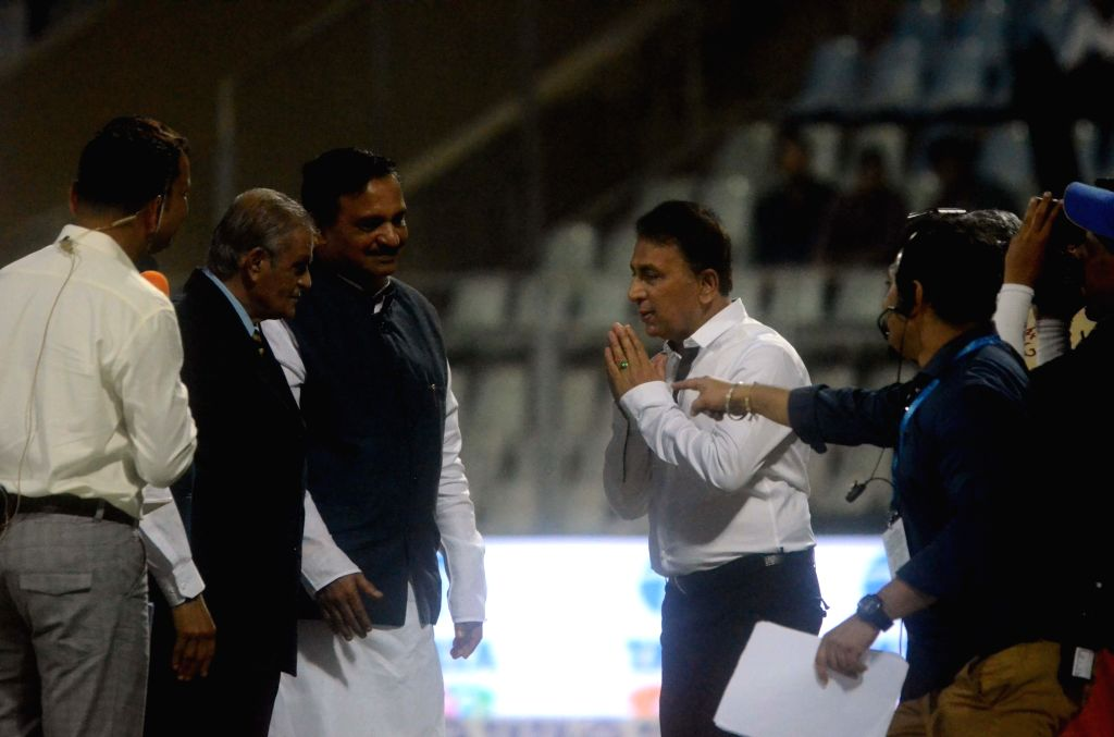 Former cricketer Sunil Gavaskar greets Maharashtra Transport Minister Diwakar Raote ahead of Horn Not Ok Please T20 Cup match at Wankhede Stadium in Mumbai on March 24, 2018. - Diwakar Raote